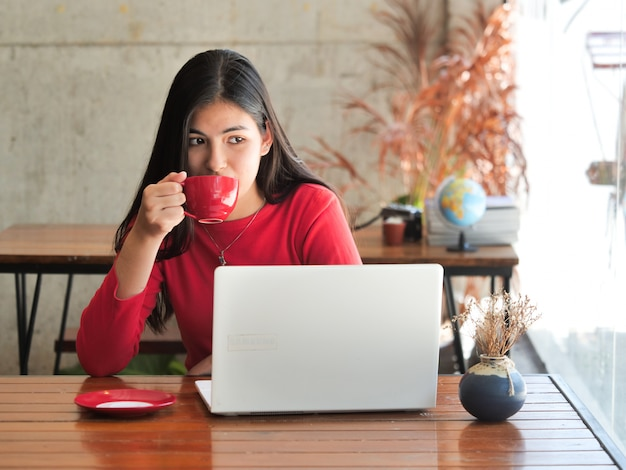 Asian woman drinking coffee and relax in coffee shop cafe