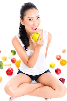 Asian woman eating and living healthy