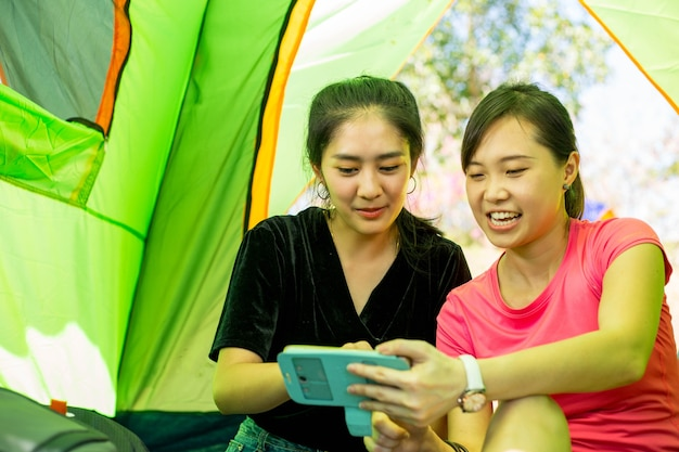 Asian woman enjoy together in summer camp  in thailand