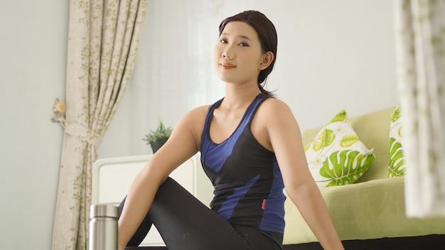 Asian woman enjoying her yoga practice at home