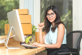 Asian woman entrepreneur working with computer