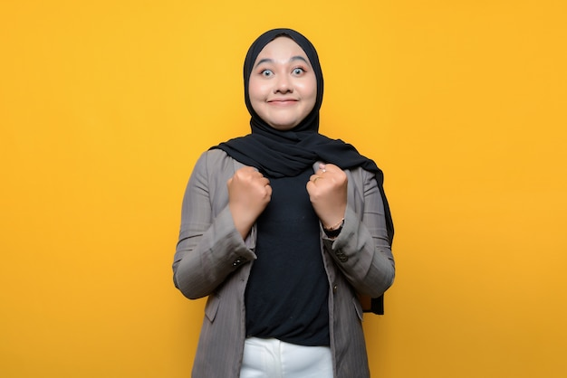 Asian woman excited on yellow