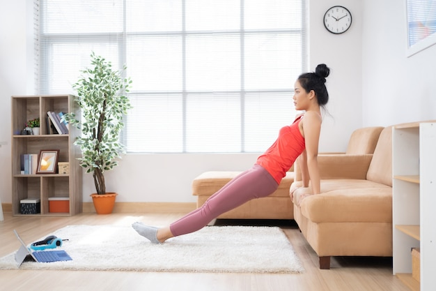 Asian woman exercise at home.