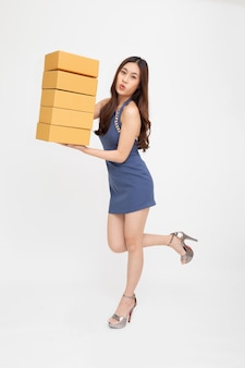 Asian woman feeling wow and holding package parcel box isolated on white background
