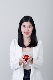Asian woman hand holding a christmas red ball