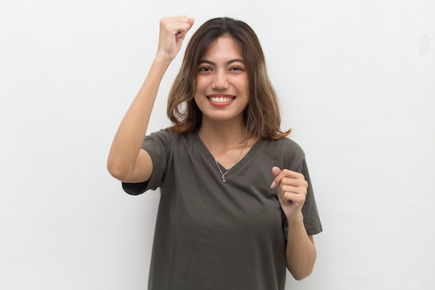 Asian woman happy and excited celebrating victory expressing big success power energy and positive emotions