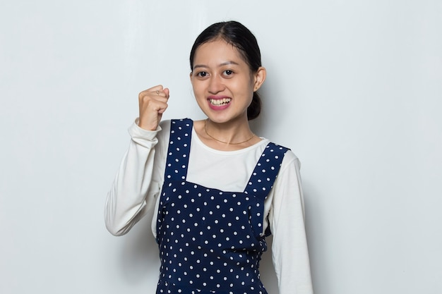 Asian woman happy and excited celebrating victory expressing big success