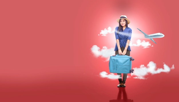 Asian woman in hat with suitcase bag going traveling with airplane background