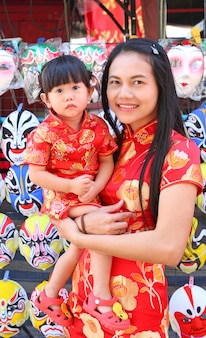 Asian woman and her daughter in tradition chinese dress, chinese new year.