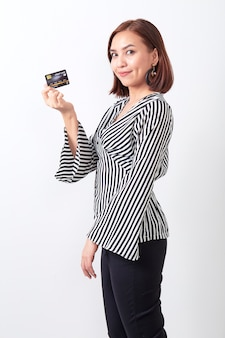 Asian woman holding credit card