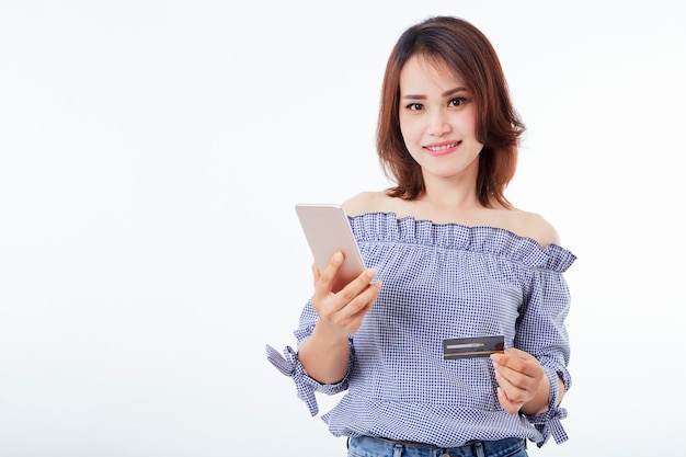 Asian woman holding smartphone and credit