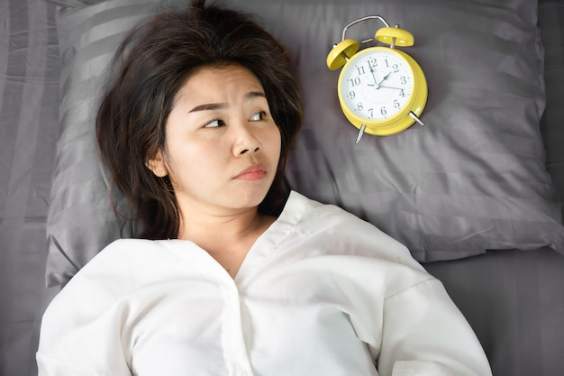 Asian woman insomnia and overthinking  in bed