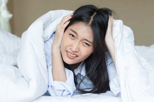 Asian woman is not happy to wake up