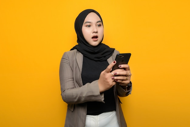 Asian woman is shocked to see smartphone