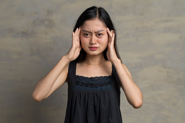 Asian woman is standing headache on the background