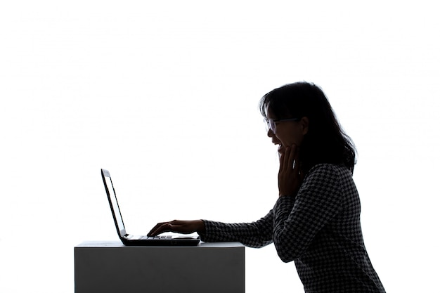 Asian woman joy while using a notebook computer.
