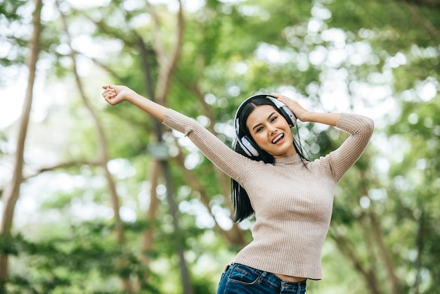 Asian woman listening favorite music on headphones. happy time and relax.