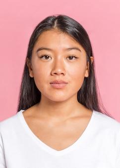 Asian woman looking at camera