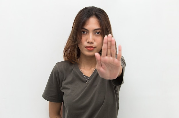 Asian woman making stop gesture with her hand
