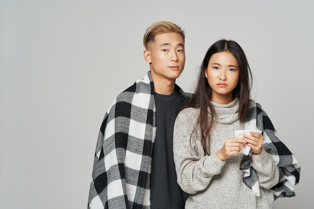 Asian woman and man on bright color posing model together