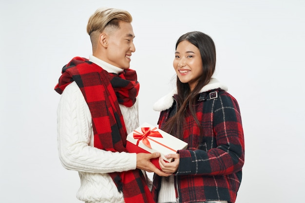 Asian woman and man on bright color surface posing model together
