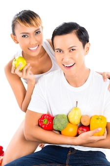 Asian woman and man eating and living healthy