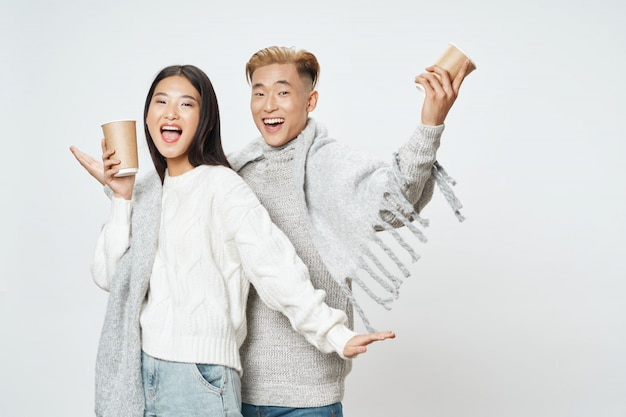 Asian woman and man posing model together