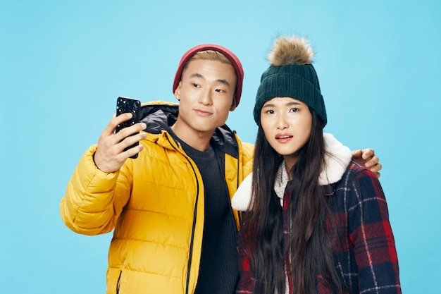 Asian woman and man taking selfie