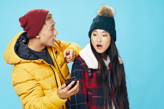 Asian woman and man on winter clothes