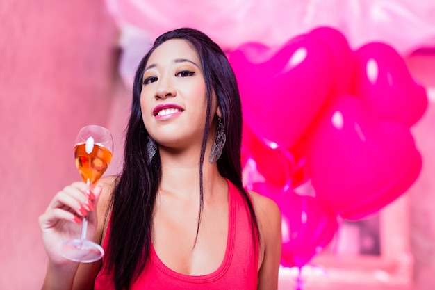 Asian woman partying in night club