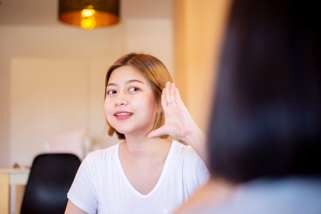 Asian woman patient deaf hearing talking with specialist sign language and showing hands gesture