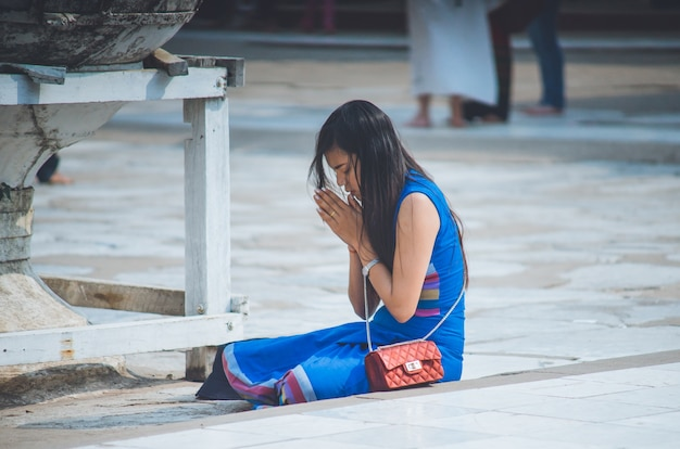 Asian woman to pay respect in worship