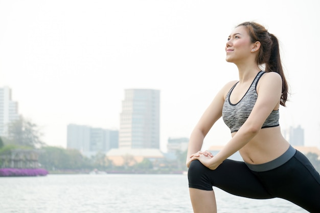 Asian woman people warm up for running and yoga