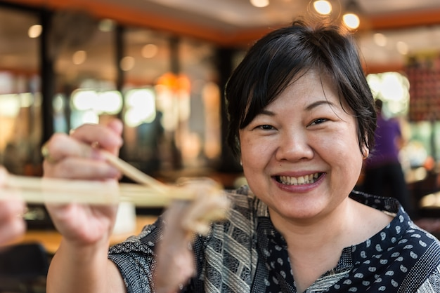 Asian woman plump body holding a raw meat beef and pork (barbeque, bbq)