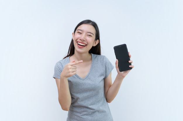 Asian woman pointing mobile phone, holding, blank screen mobile phone
