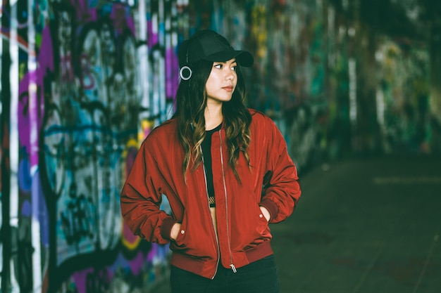 Asian woman portrait with blurred graffiti