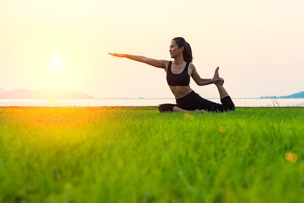 Asian woman practice yoga at morning,asian woman in yoga pattern exercise for healthy life :concentr