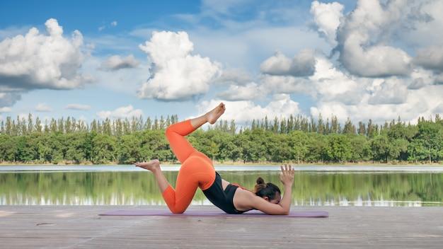 Asian woman practicing yoga pose