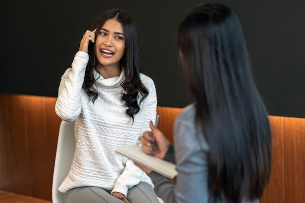 Asian woman professional psychologist doctor giving the consult to female patients in livi