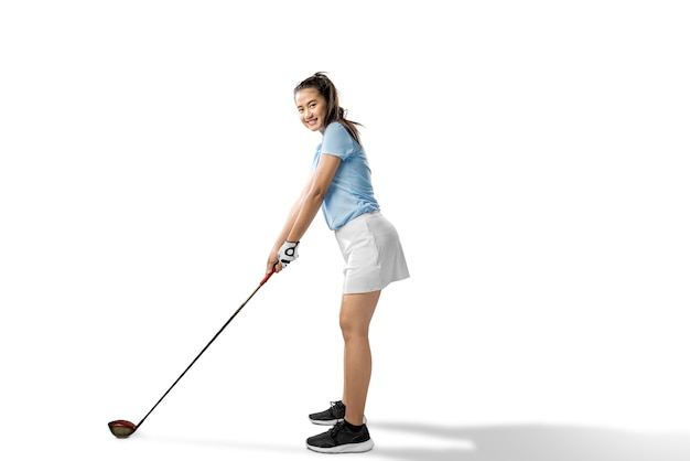 Asian woman ready to swing the wood golf club