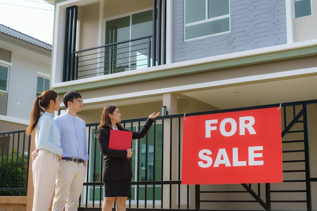 Asian woman real estate broker agent showing a house detail