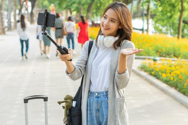 Asian woman recording video on the street in hanoi, vietnam