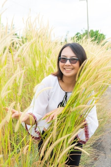 Asian woman relax in grass field.