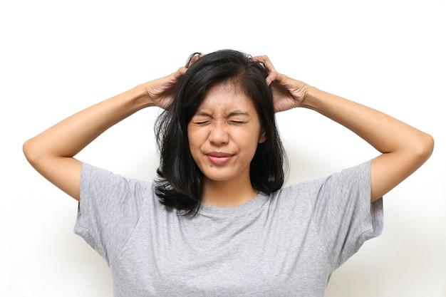 Asian woman scratching her head