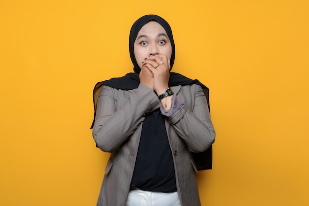 Asian woman shocked and covering mouth