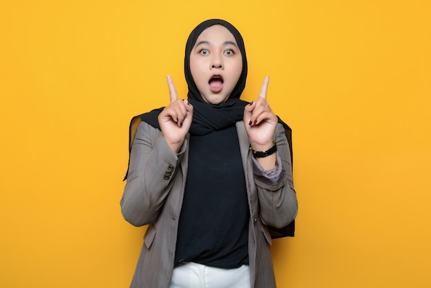 Asian woman shocked and pointing up
