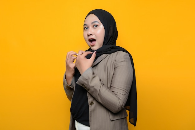 Asian woman shocked on yellow