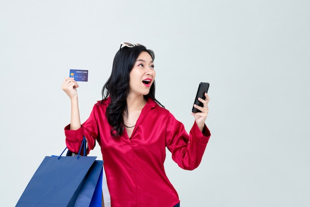 Asian woman shopping online and pay with credit card