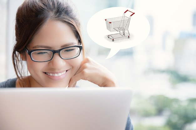 Asian woman shopping online