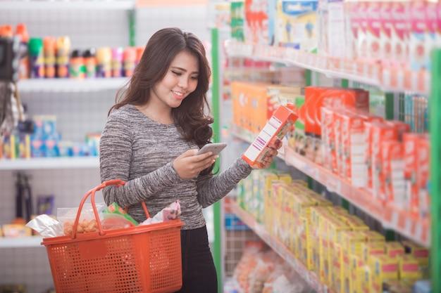 Asian woman shopping at supermarket